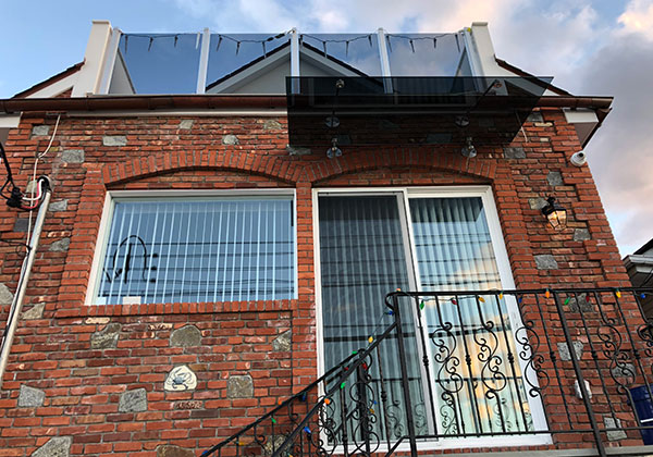 Gray Glass Awning, Glass Railing system, Window and Door